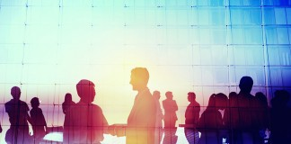 41343345 - silhouette global business people meeting concept