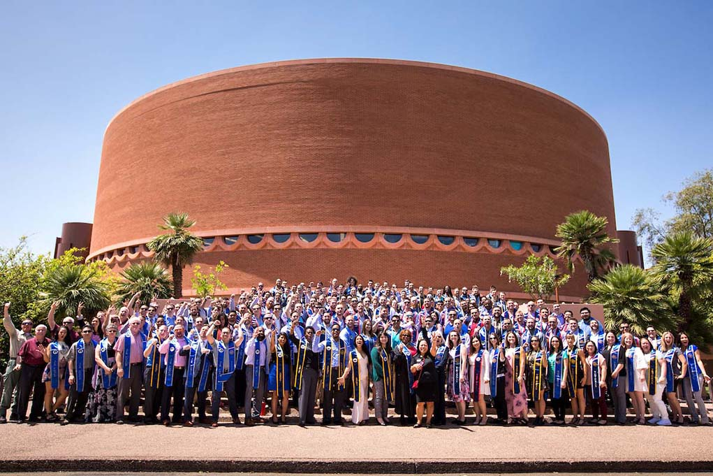 Graduating military veterans pose for a photo on Tempe Campus, May 6, 2017, after a ceremony where they were presented with honor stoles, which identify them with the branch of military service in which they are serving or served. Over 7,200 military affiliated students currently attend ASU, including veterans, active duty, National Guard, reservists and family members. (Photo by Charlie Leight/ASU Now)
