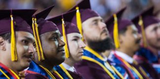 ASUNOW - 05/08/2017 - Sun Devil Stadium - Veteran graduates listen as Starbucks CEO Howard Schultz addresses students during the spring 2017 commencement Monday evening in Tempe, Ariz. Photo by Deanna Dent/ASUNow